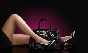 fashionable woman with a black bag, fashion photo